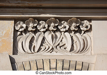 Ornate wall with floral pattern. Detail of building in...