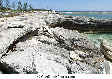 Eroded Bahamian Beach - The view of a beach under heavy...
