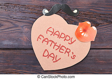 Father's Day card and props. Heart-shaped card on wood. Cute...