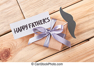 Father's Day gift and mustache. Greeting card and present...