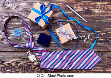 Tie and watch for father. Greeting card and pen. Classic...