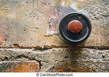 Antique door bell - Old vintage door bell button on grunge...