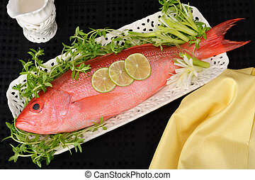 Red Snapper fish. - Red snapper fish on white platter.