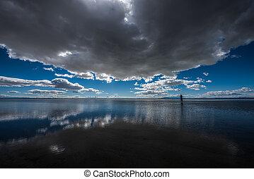 Bonneville Salt Flats Utah - Tourist standing in a shallow...