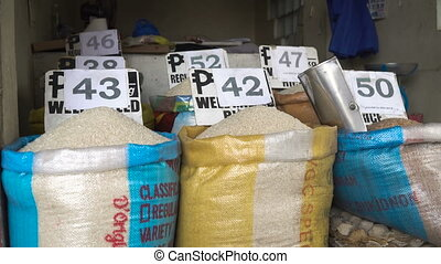 Rice at the asian market. - Rice for sale at the asian...