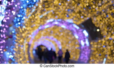 The tunnel of glowing lights. Decorating for Christmas