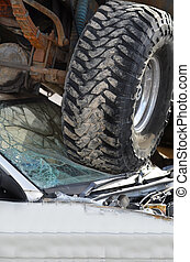 Car Wreck With Truck Tires on Windshield of Small Car Crash...