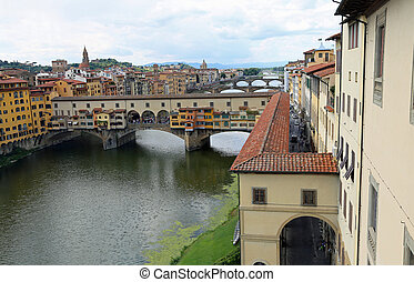 ancient bridge called Ponte Vecchio and Vasari Corridor in...