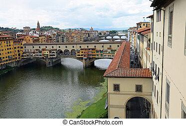 ancient bridge called Ponte Vecchio and Vasari Corridor in...
