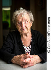Portrait of an elderly gray-haired woman pensioner.