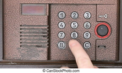 Person opening door using a numeric code of access