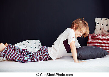 smiling kid waking up languidly in the morning