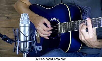 Musician Recording Acoustic Guitar in Microphone on the Home...