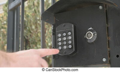 Person pushing buttons on the panel of intercom - Person...