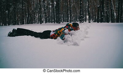 Man Jumps and Dives Headlong into the Snow and Have Fun in...