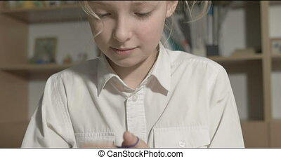 Young girl learn to knit in the classroom or room - Two...