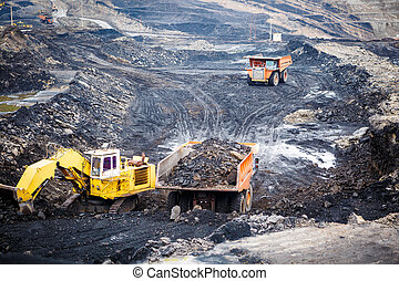 Mining dump trucks working in Lignite coalmine