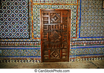 Interior of Casa de Pilatos - Wooden door and tile art:...
