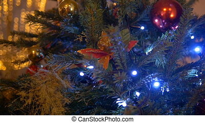 New Year's balls hang on the Christmas tree, colored...