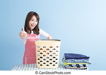 beauty housewife thumb up with ironing and shirt isolated on...