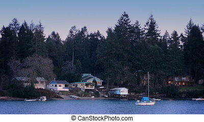 Houses And Boats By Shore At Sunset - Waterfront houses with...