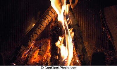 Wood burning in the fireplace, slow motion, close-up