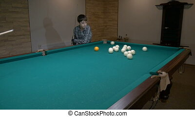 Russian billiards. Father teaches son to play pool - Russian...