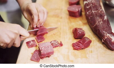 preparation meat cutting for cooking in kitchen at restaurant.