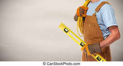 Electrician with electrical cable - professional...