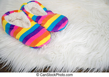 rainbow slippers on fur rug - rainbow slippers on white fur...
