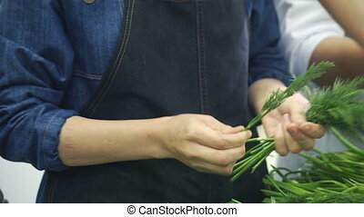 slow motion cookers plucked dill in industrial kitchen at...