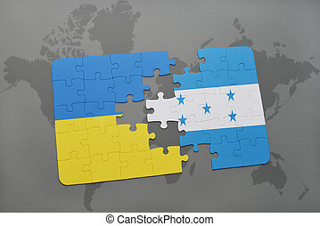 puzzle with the national flag of ukraine and honduras on a...