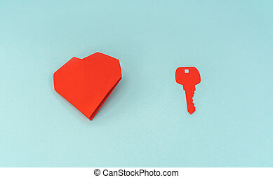 Paper cut of Key for heart as a symbol of love . - Paper cut...