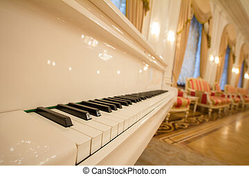 Classical Piano - white and black keys. Golden luxury...