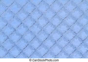 mesh netting covered with frost