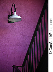 Pink stairwell - Stairs leading into a beautiful pink-walled...