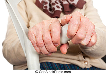 Elderly hands holding a crutch - Close up picture of old...