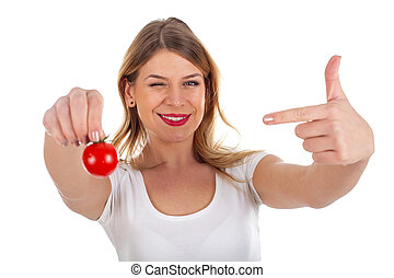 Funny woman holding cherry tomato - Picture of a funny young...