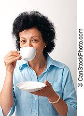 Elder Woman Drinking Tea.
