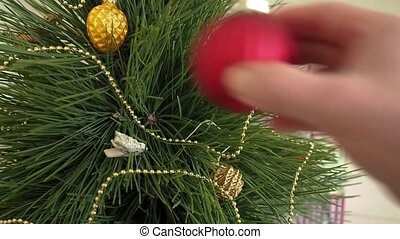 Man decorates a Christmas tree.