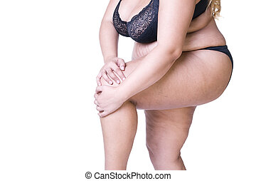 Plus size model in black lingerie, overweight female body, fat woman with thick thighs isolated on white background