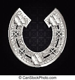Silver horseshoe on a dark background