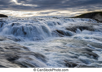 Gullfoss Falls Iceland on Iceland with dark and light clouds...