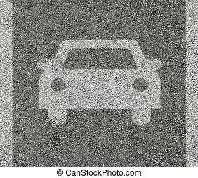 Car sign on asphalt