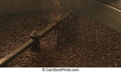 Coffee bean roaster at work in a production room - Machine...