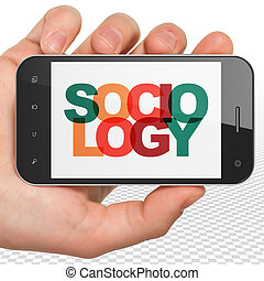 Learning concept: Hand Holding Smartphone with Sociology on...