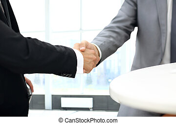 Business people shaking hands over a deal