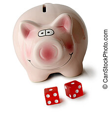 Money gamble - Piggybank and two red dice focuse on...