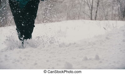 Man dives head first into the Deep Snow and Have Fun in the Winter Forest. Slow Motion