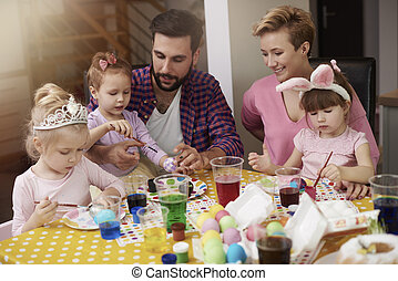 Parents with daughters over the colorful table